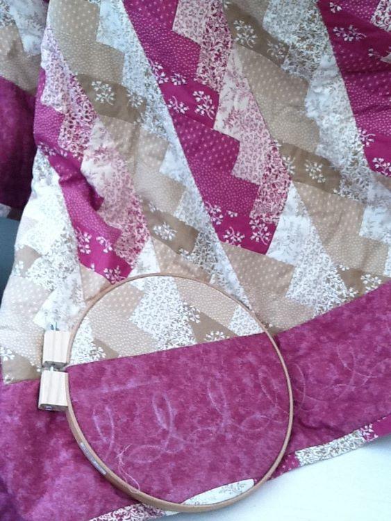 Friendship braid quilt with hand stitched border design