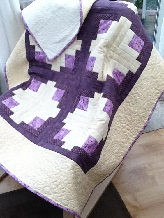 A modern take on a traditional log cabin quilt design