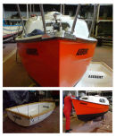 On this selection of boat pictures you can see the vinyl lettering being applied to the boat.