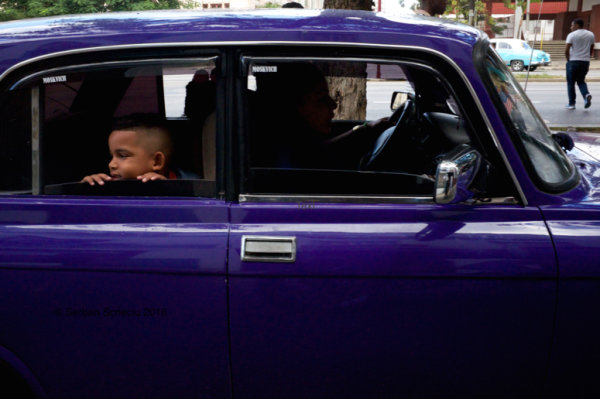 boy in purple car