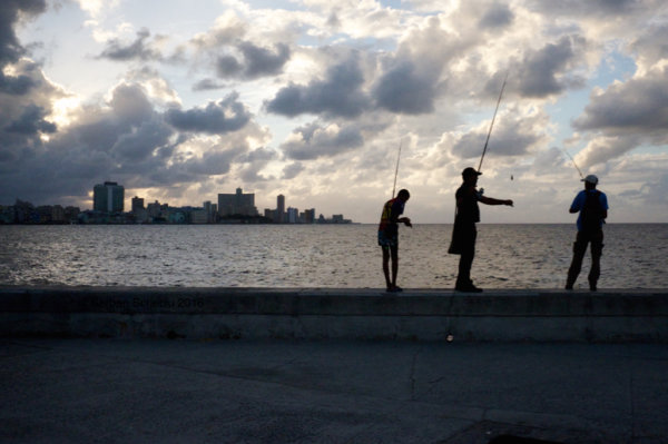 urban fishing against sunset