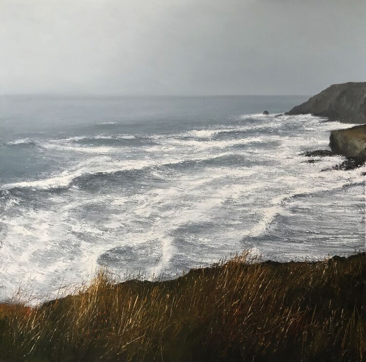 Distant Cornish headland enveloped by the mizzle
