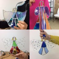 Angel glass hangings made at a Sarah Davis Glass workshop
