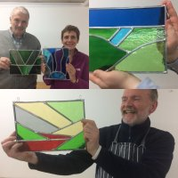 Landscape stained glass panels made at a Sarah Davis Stained Glass workshop