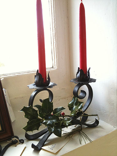 Hand forged iron candelabra -one of two
