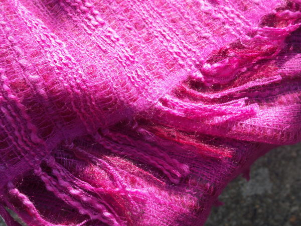Pink scarf tassle detail