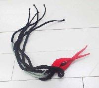 black red flower by Tadek Beutlich