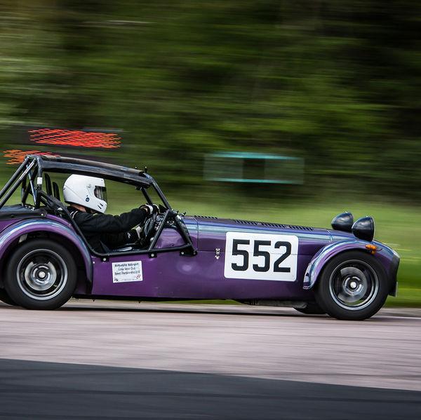 Purple caterham 7 at speed on curborough sprint track
