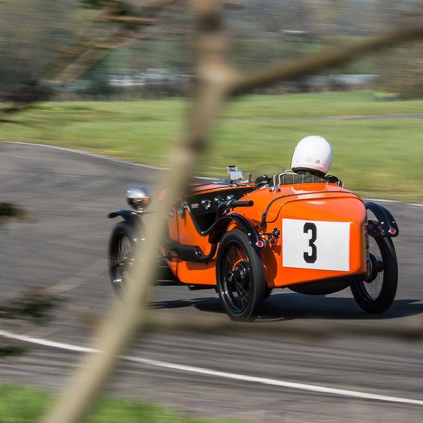 orange vintage racing car at speed on curborough sprint course