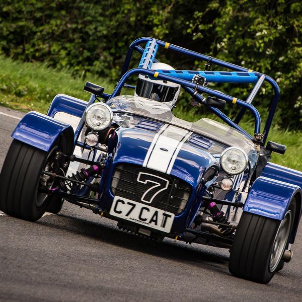 blue caterham 7 rounding the fradley hairpin corner at curborough sprint track