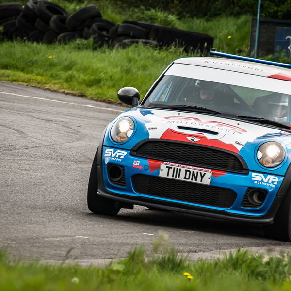 Blue Mini turning into the hairpin at speed on Curborough Sprint Course