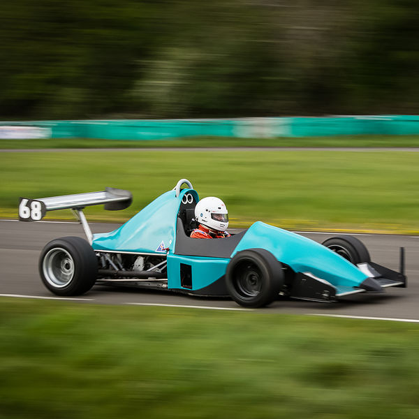 light blue motorcycle engined race car as speed on curborough sprint track