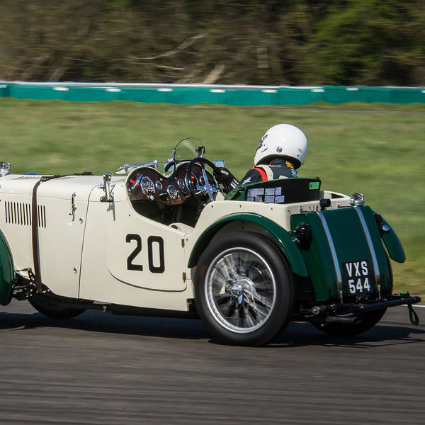 cream coloured vintage racing car at speed on curborough sprint course