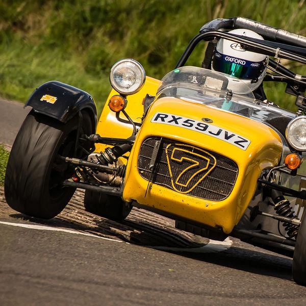 aluminium and yellow caterham 7 rounding the fradley hairpin corner at curborough sprint track