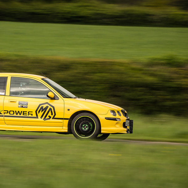 yellow mg rover 25 speeding along curborough race track