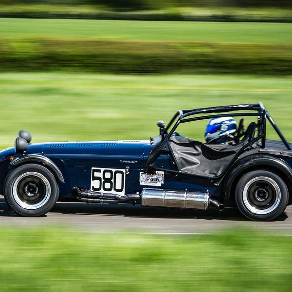 Dark Blue Caterham 7 at speed along the Curborough sprint course shenstone straight