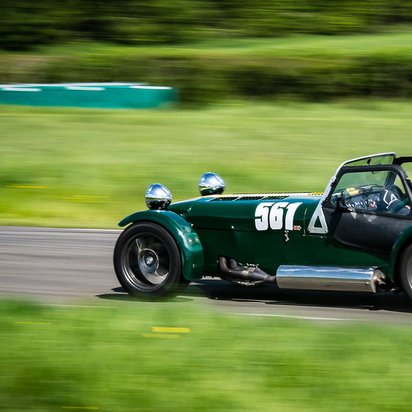 Green Caterham 7 at speed along the Curborough sprint course shenstone straight