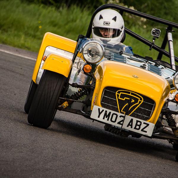 yellow and aluminium caterham 7 rounding the fradley hairpin corner at curborough sprint track
