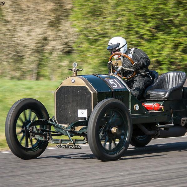 green vintage racing car negotiating the curborough hairpin at speed