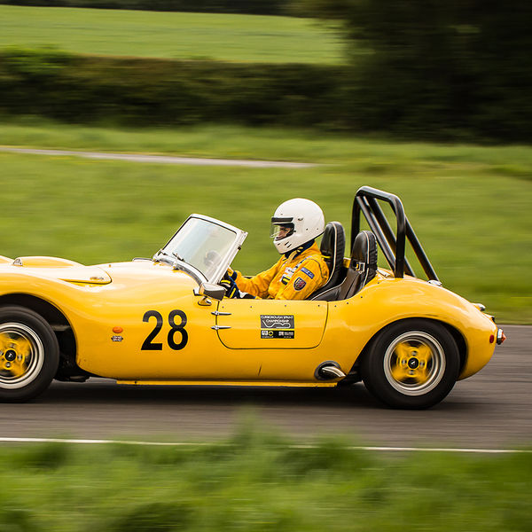 yellow sports car exiting fradley hairpin at speed