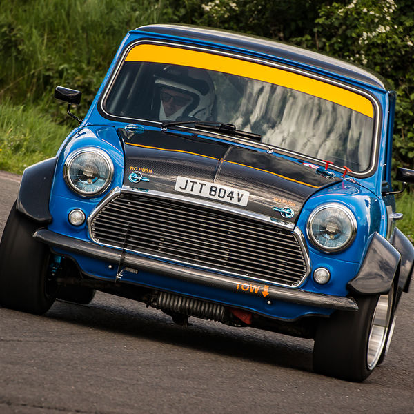 classic blue mini cooper taking the fradley hairpin at speed