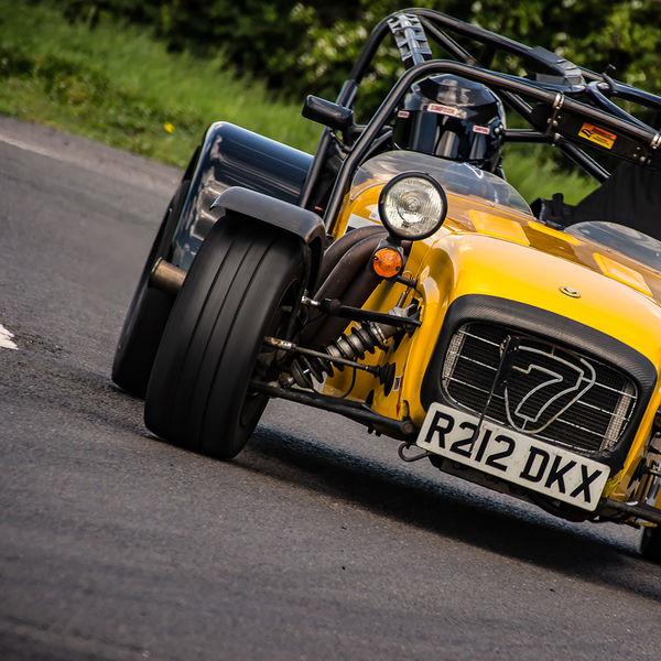 yellow caterham 7 rounding the fradley hairpin corner at curborough sprint track