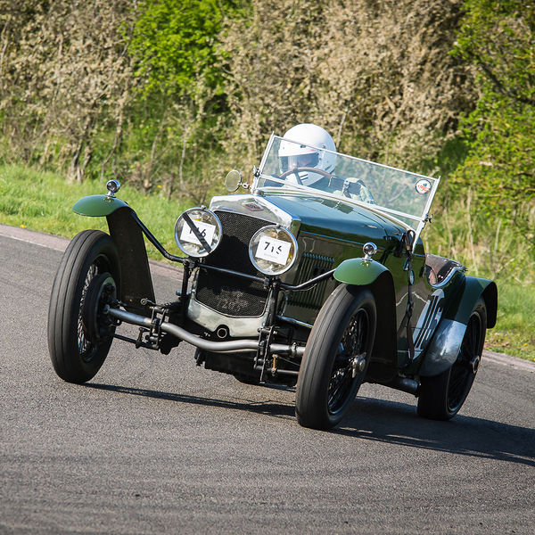 green vintage racing car at speed on curborough sprint course