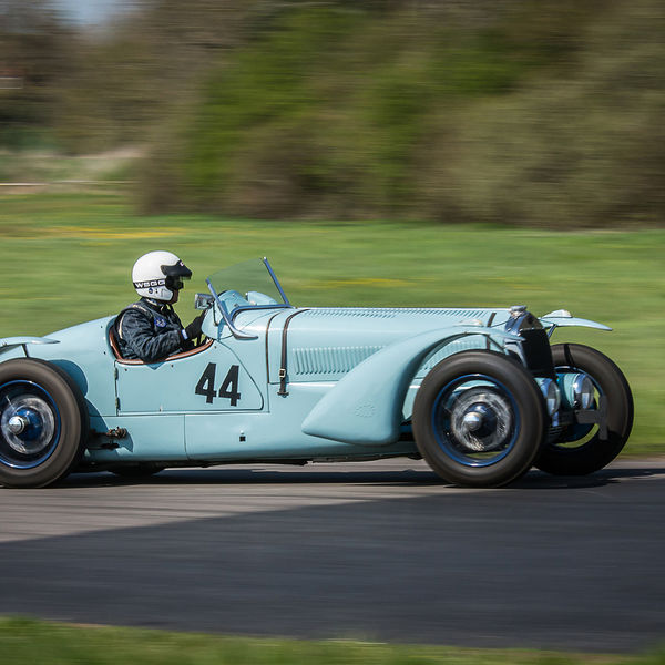 Blue vintage racing car at speed along curborough sprint track