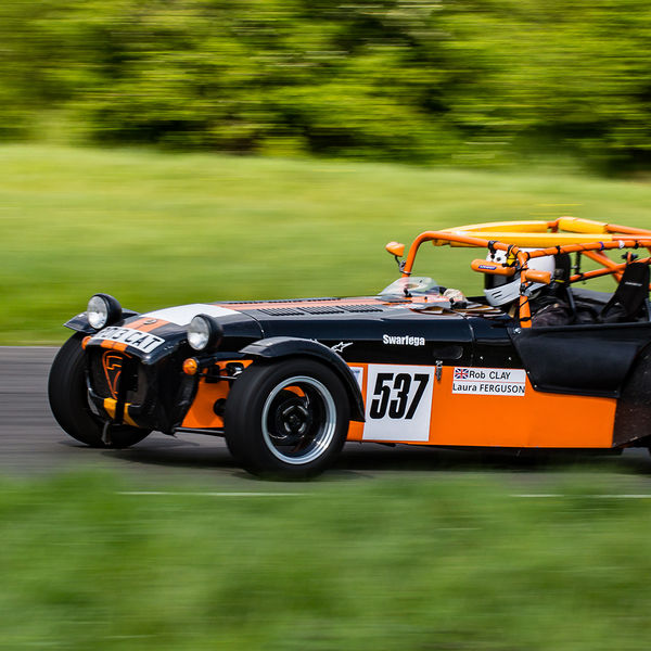 Orange and black Lotus 7 Caterham Westfield at speed on Curborough Sprint Course