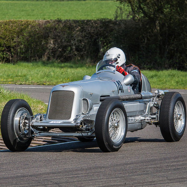 Silver vintage racing car at speed on curborough sprint course