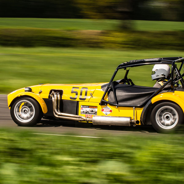 Yellow Lotus 7 Caterham Westfield at speed on Curborough Sprint Course