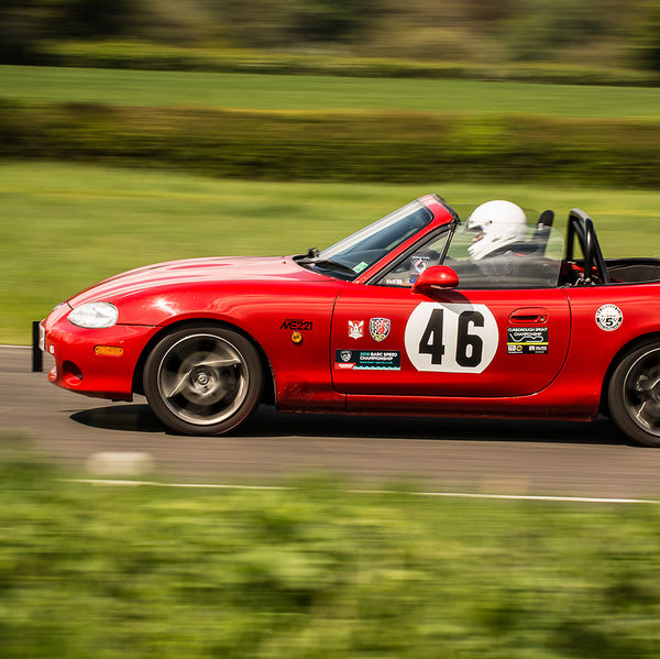 red mazda mx5 speeding during a curborough track day