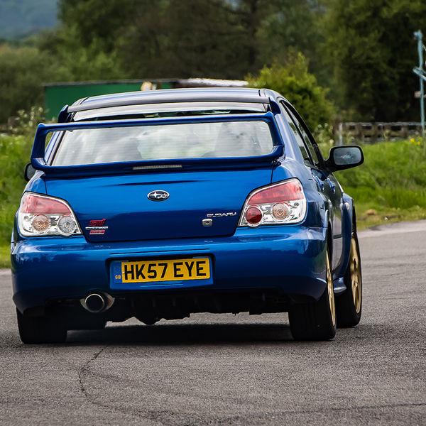 Blue Subaru Impreza exiting the hairpin at speed on Curborough Sprint Course