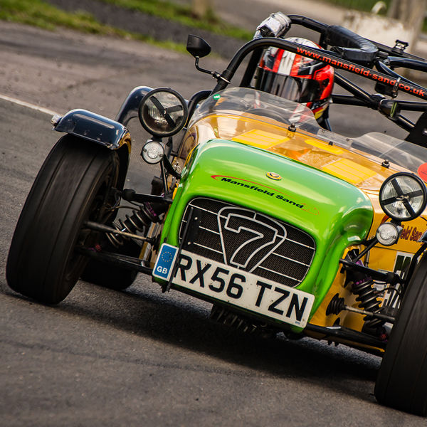 lime green and yellow caterham 7 rounding the fradley hairpin corner at curborough sprint track