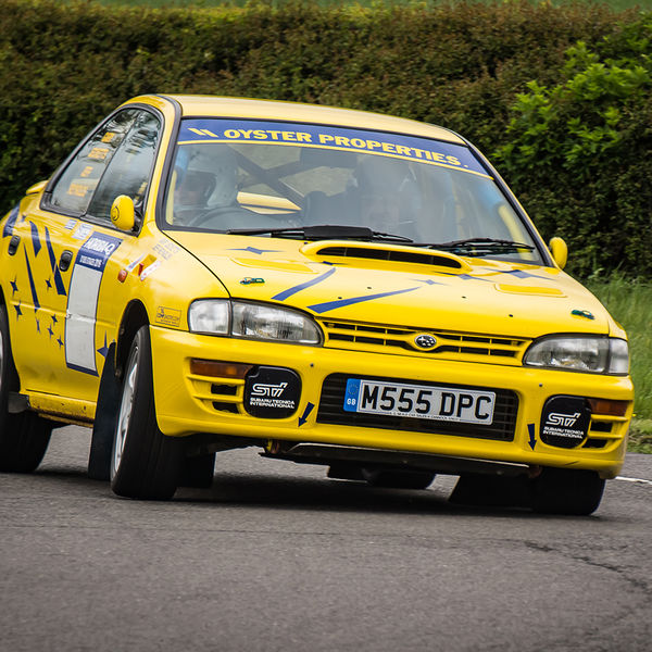 Yellow Subaru Impreza turning into the hairpin at speed on Curborough Sprint Course