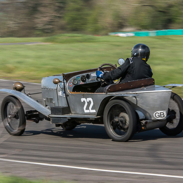 Aluminium vintage racing car at speed on curborough sprint course