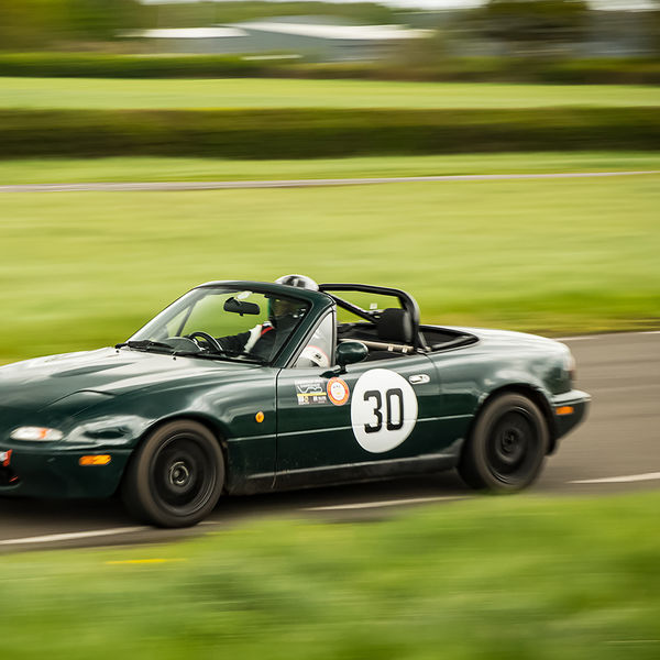 green mazda mx five at speed on curborough shenstone straight
