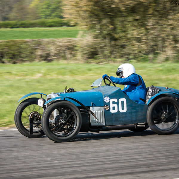 Blue vintage racing car at speed on curborough sprint course