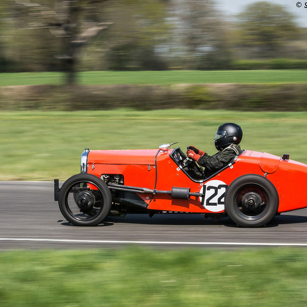 red vintage racing car at speed on curborough sprint course