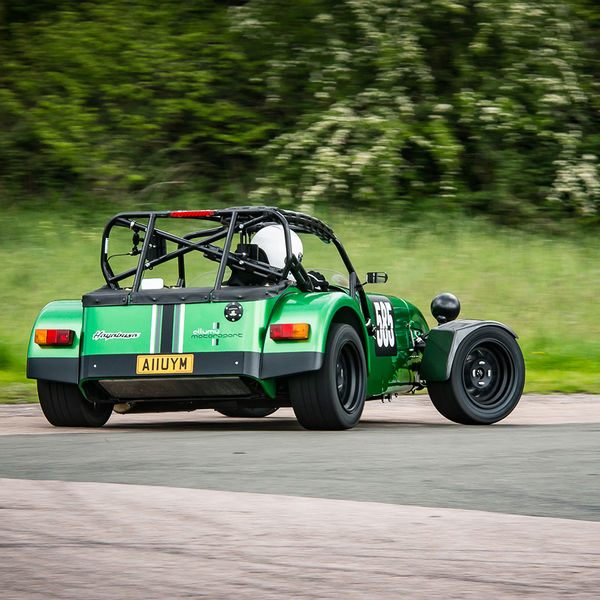 Green Lotus 7 Caterham Westfield at hairpin bend on Curborough Sprint Course