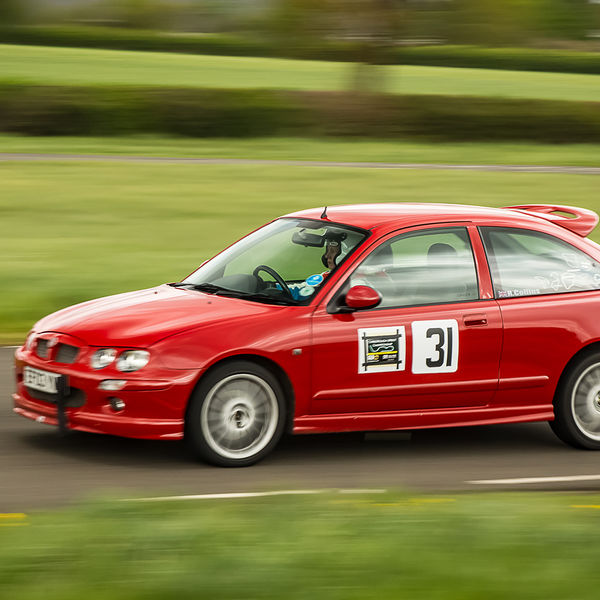 bright red mg rover 25 at speed on curborough shenstone straight