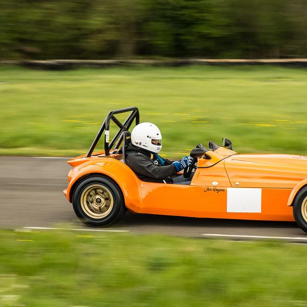 Orange Lotus 7 Caterham Westfield at speed on Curborough Sprint Course
