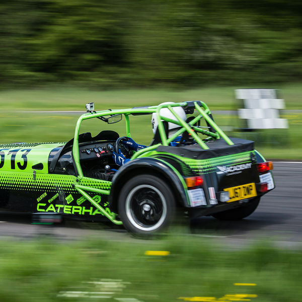 Bright green Caterham 7 at speed along the Curborough sprint course shenstone straight