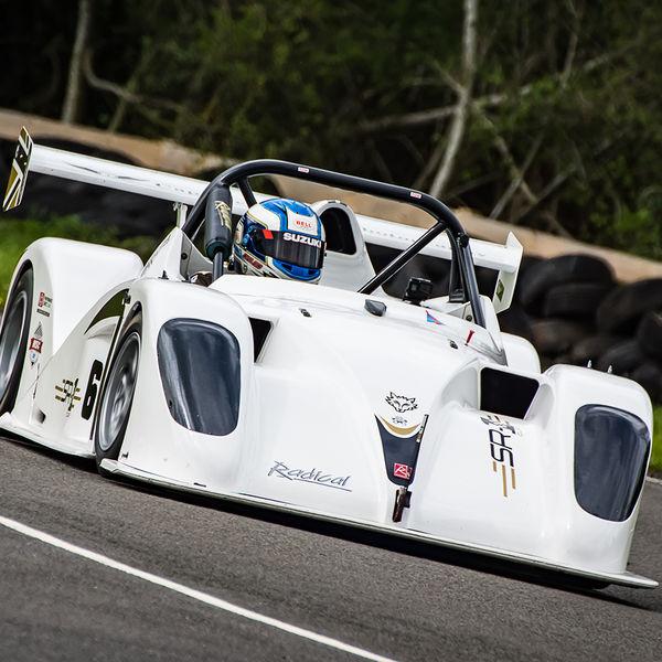 white radical race car at speed through molehill corner at curborough sprint track