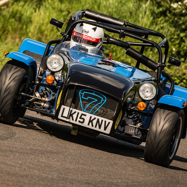 bright blue caterham 7 rounding the fradley hairpin corner at curborough sprint track