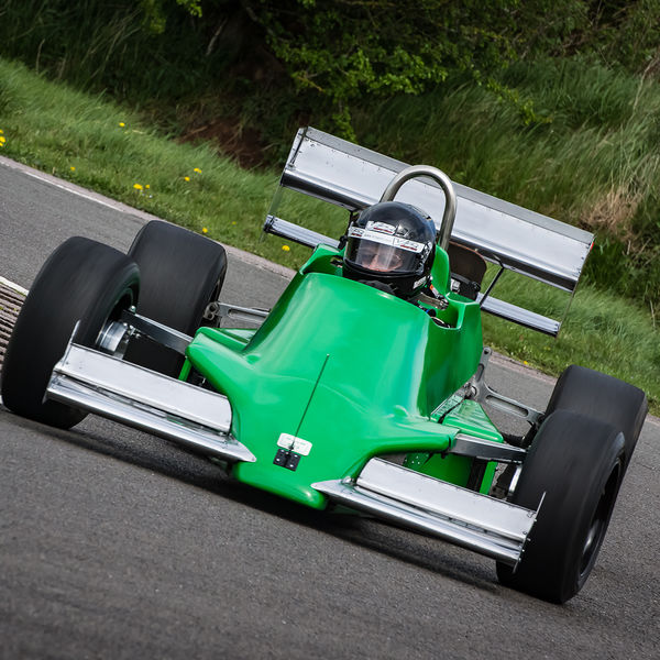 green motorcycle engined race car rounding curborough sprint track fradley hairpin corner