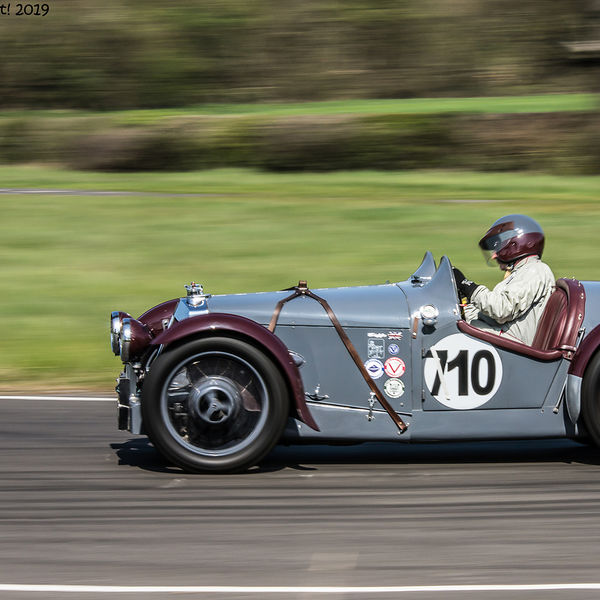 grey and maroon vintage racing car at speed on curborough sprint course