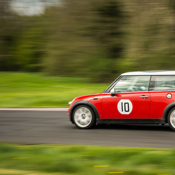 red mini hatchback at speed on curborough shenstone straight