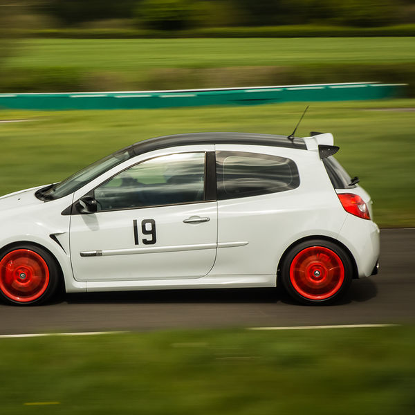 white renault clio with red wheels at speed on curborough shenstone straight