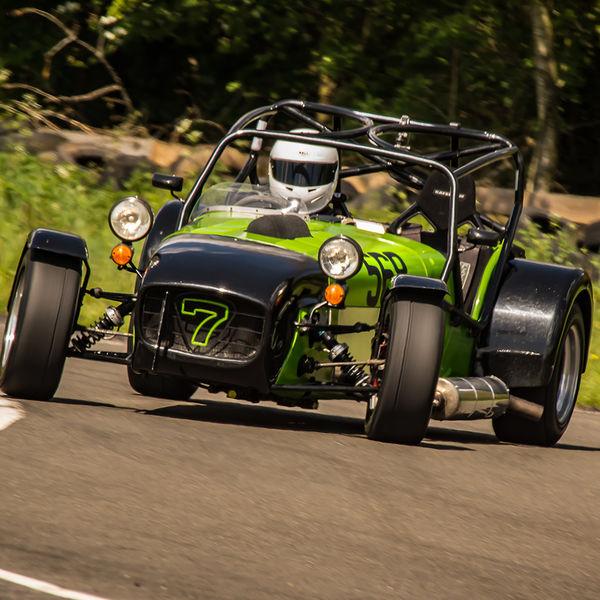 bright green caterham 7 opposite lock through curborough sprint course mole hill corner